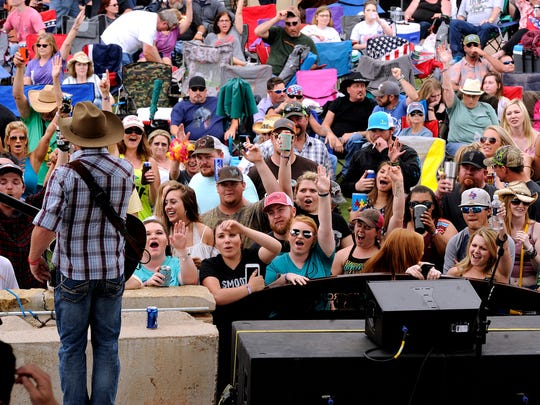 Fans cheer as Kyle Park performs during the 2017 Outlaws