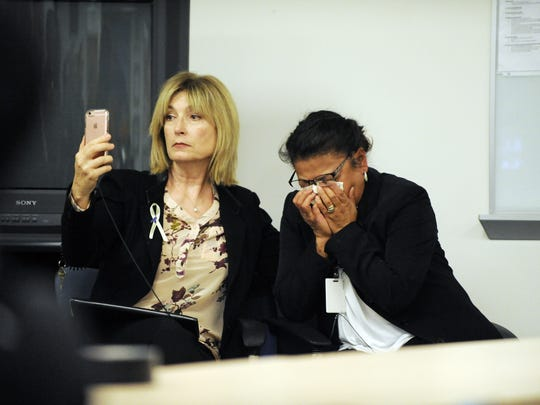 At a press conference on Thursday in Salinas, an unnamed family member, right, listens as authorities announce charges in the 1998 murder of Christina Marie Williams.