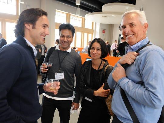 From left, Nolan Paul of Driscoll's, Dr. Amitava Bhaduri,