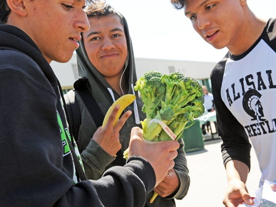 Broccoli and bananas are on the menu for these young men at Alisal High School's first Community Health and Wellness Fair.
