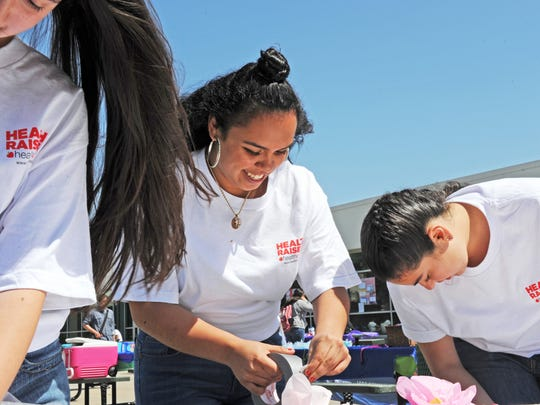 Students participating in Alisal High School's first Community Health and Wellness Fair prepare their display on Thursday.