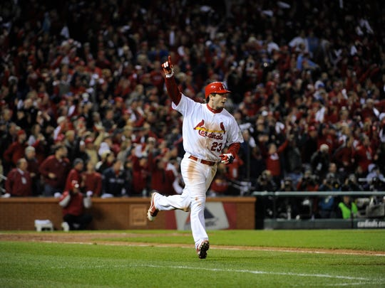 David Freese celebrates his game-winning, 11th-inning