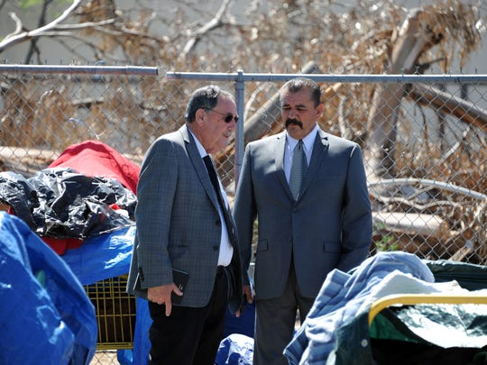 Framed by possessions of the homeless in the parking lot behind 20 Soledad St., Mayor Joe Gunter and City Councilmember Tony Barrera discuss the possibility of using the building as a temporary warming shelter.