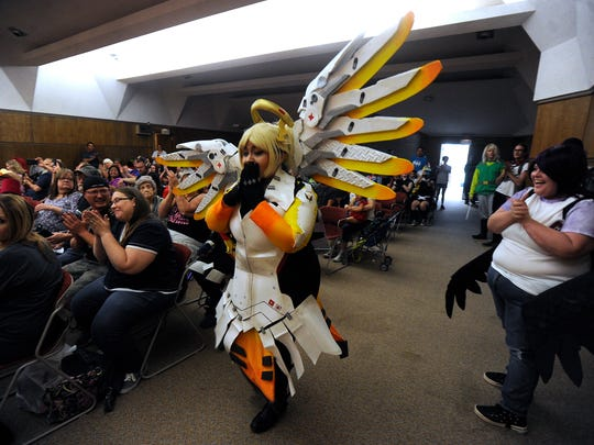 Josie Medina, dressed as Mercy from the video game,