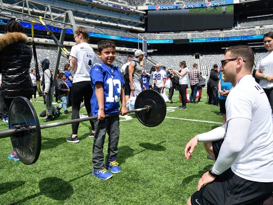 Victor Soto,5, of Bogota shows off his strength at the 5th annual Health and Fitness Expo at Metlife Stadium in East Rutherford on Saturday, May 6, 2017.