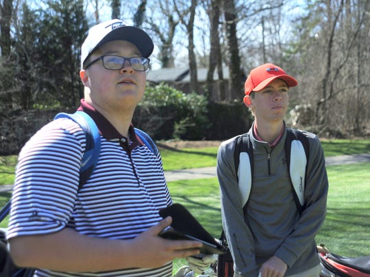 Owen senior Brock Pressley, left, plays a round at the Black Mountain Golf Course on March 23.