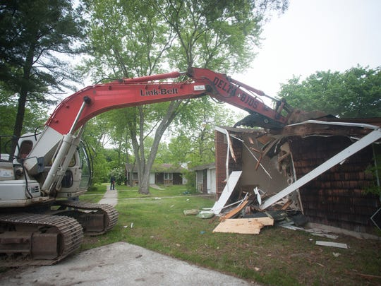 A bulldozer operates during the demolition of homes at Ellis Manor in Glassboro N.J.