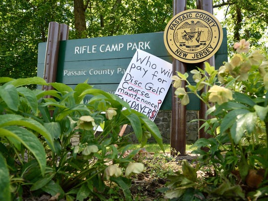 A protest sign Sunday at the entrance to Rifle Camp