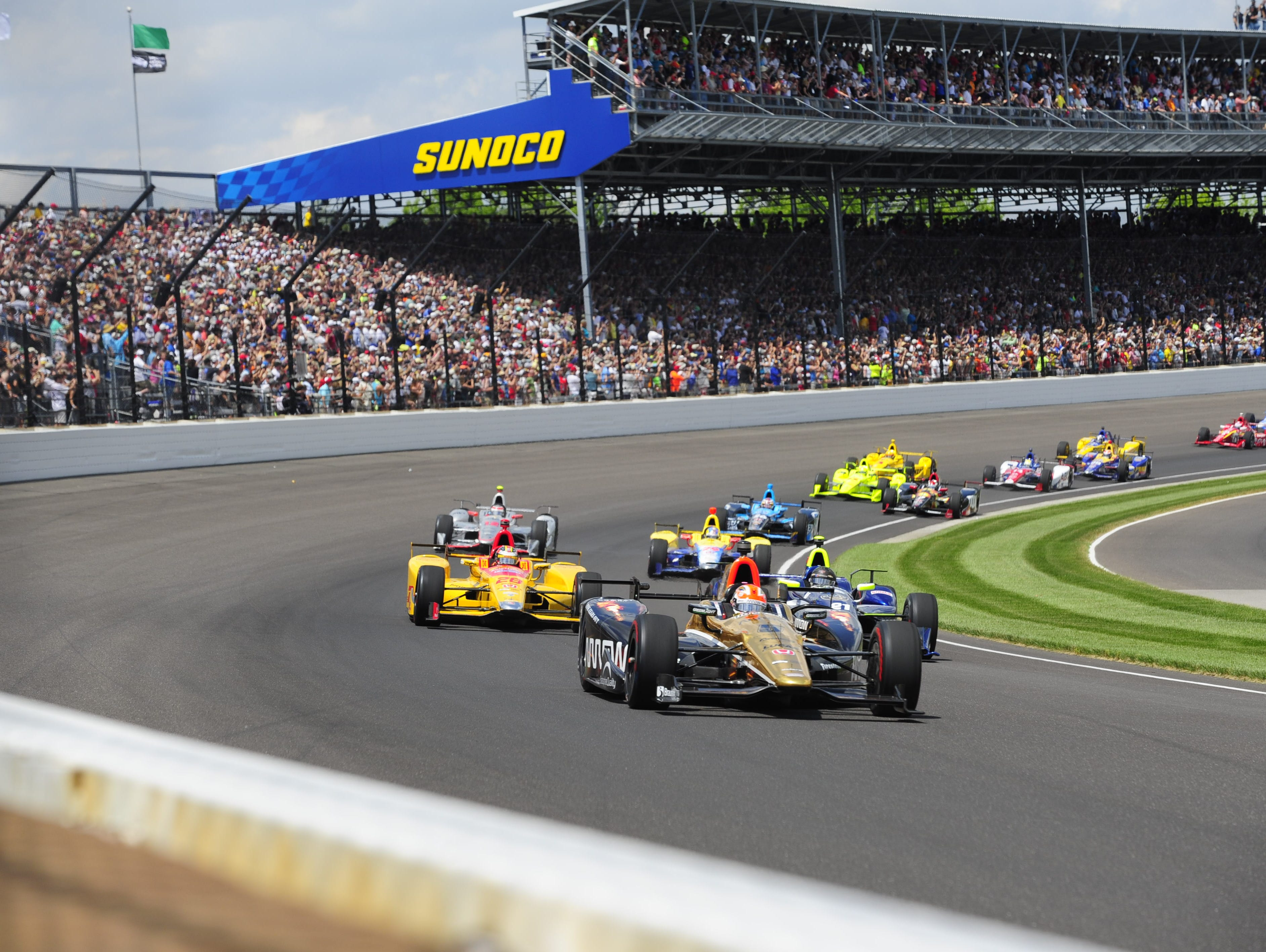James Hinchcliffe leads the field through the first turn of the 100th running of the Indianapolis 500 last May.