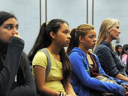 King City sixth-graders and their teacher Robyn Wallker, right, listen to Holocaust survivor Harold Gordon on Tuesday.