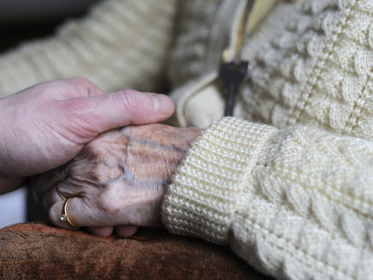 A woman, suffering from Alzheimer's dese