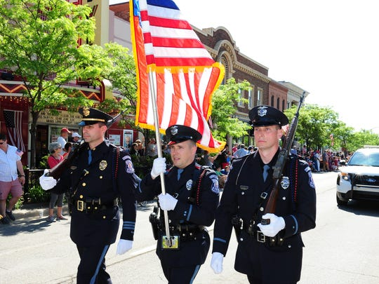 Farmington Honor Guard Police Officers proudly display the colors of our country at this years Memorial Day Parade in downtown Farmington.