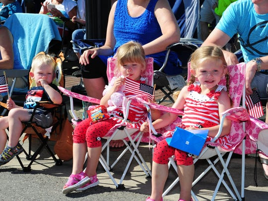 Benjamin Cowden along with sisters Adeline and Amelia enjoy a beautiful day for the annual Memorial Day Parade held in downtown Farmington on Monday. For more photos from the event, please see inside.