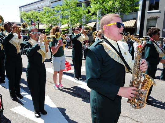 Farmington Harrison High School Marching Band entertain the large crowd at this years Memorial Day Parade in Farmington.