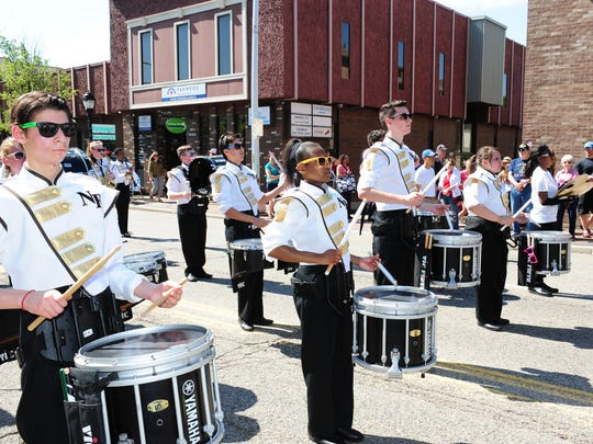 North Farmington High School Marching Band thrills the crowds of people who attended the annual Memorial Day Parade in downtown Farmington on Monday.