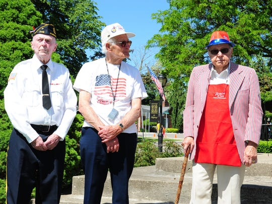 Farmington Memorial Day Parade Grand Marshals Jim Forbes, Virgil Thill and Ray Okonski are thanked for their service to their country during the ceremony held after the Memorial Day Parade in downtown Farmington.
