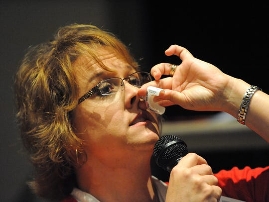 Denise Ream demonstrates how to give a patient naloxone