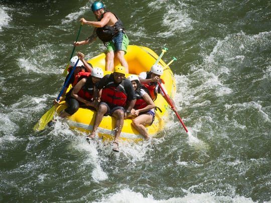 Sunburst Adventures, a commercial rafting business, takes a group of rafters down the Ocoee River on Sunday, August 14, 2016. (SAUL YOUNG/NEWS SENTINEL)