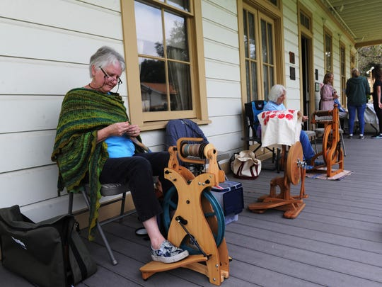 Glenda Clift, president of Ventura Hand Weavers & Spinners Guild, demonstrates fiber spinning at the 2017 Pioneer Jamboree at the Stagecoach Inn.