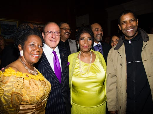 From left, Rep. Sheila Jackson Lee, Clive Davis, Aretha