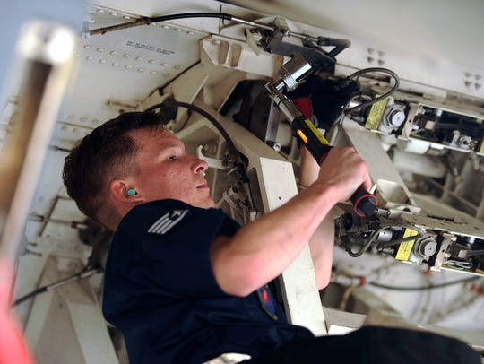Staff Sgt. Donald Winters prepares the bomb bay of