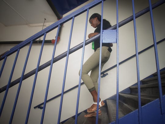 Camden High Student Omya Chambers walks down the steps to the lower level in Camden High on the last day of classes at the school.
