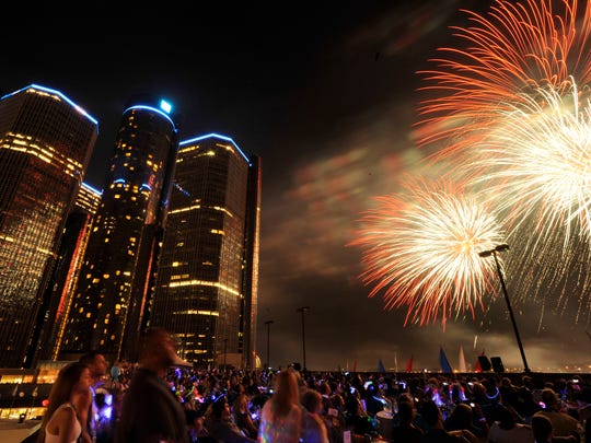 Crowds watch the fireworks from the roof of the Miller Parking Garage next to the Renaissance Center in downtown Detroit.