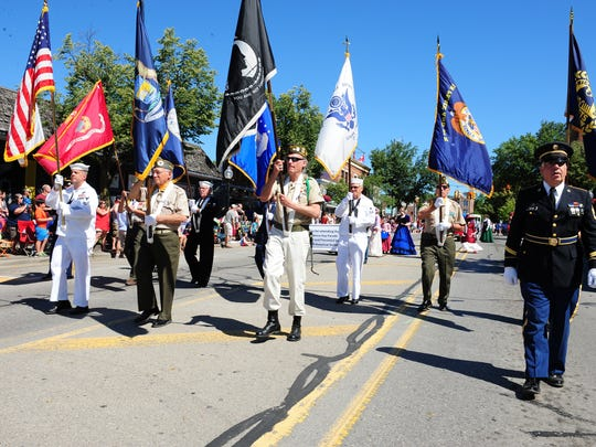 The Huron Valley AMVETS Post 2006 Color Guard displays the colors of all the Armed Forces.