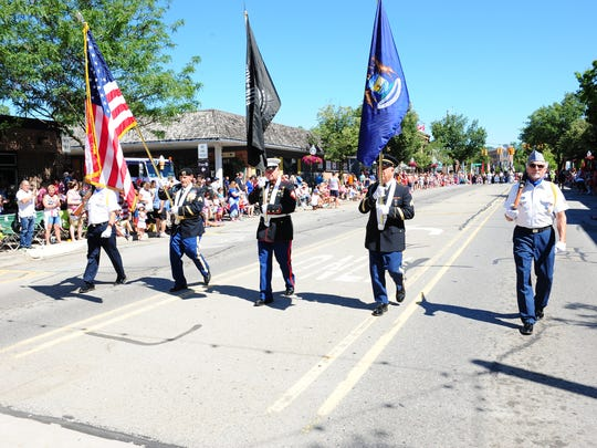 Milford American Legion Post 216 Color Guard kicks off the annual Fourth of July Parade in downtown Milford Tuesday.