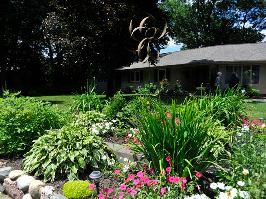 A colorful garden and well-manicured lawn greet visitors to Sharon and Irv Vollert's Wisconsin Rapids home Saturday.