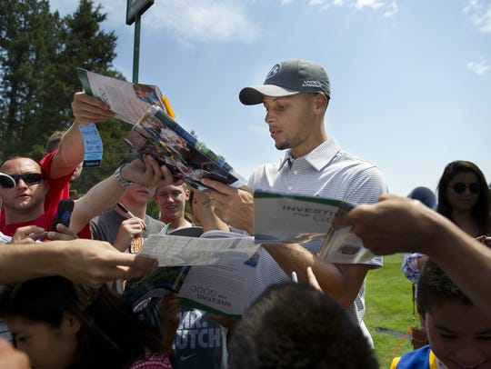 July 2014; NBA All-Star guard Stephen Curry, seen giving