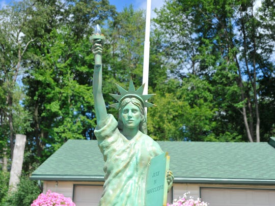 The Statue of Liberty in Helen and Herb Haydock's front yard holds her torch about nine feet in the air. Dave Oswold, owner of D.W.O. Fiberglass in Sparta, said he used the arm of a mannequin to model the arm for the statue.