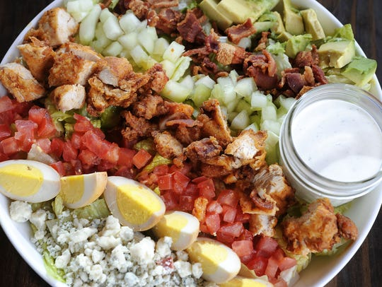 The Deconstructed Cobb salad at Party Fowl is laden with rows of sliced avocado, thick bacon bits, cucumbers, tomatoes, smoked hard-boiled eggs and blue cheese. It's one of the better Cobb salads around town.