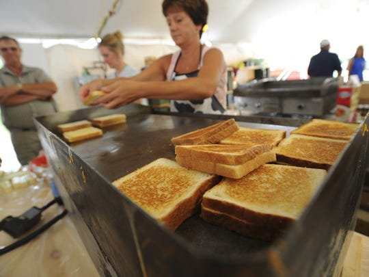 Grilled cheese sandwiches made with cheddar cheese produced by the Alto Dairy (now owned by Saputo Cheese) is a popular comfort food at the two-day fair.