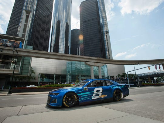 GM showcases the company's new race car, the Camaro ZL1, driven by NASCAR driver Jimmie Johnson along Jefferson Avenue in front of the General Motors Renaissance Center World Headquarters in Detroit.