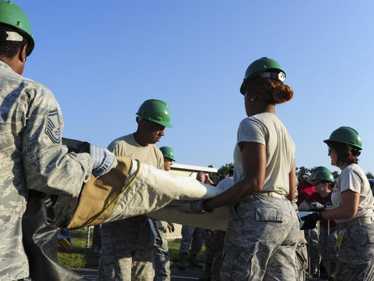 Members of the 413th Aeromedical Staging Squadron set