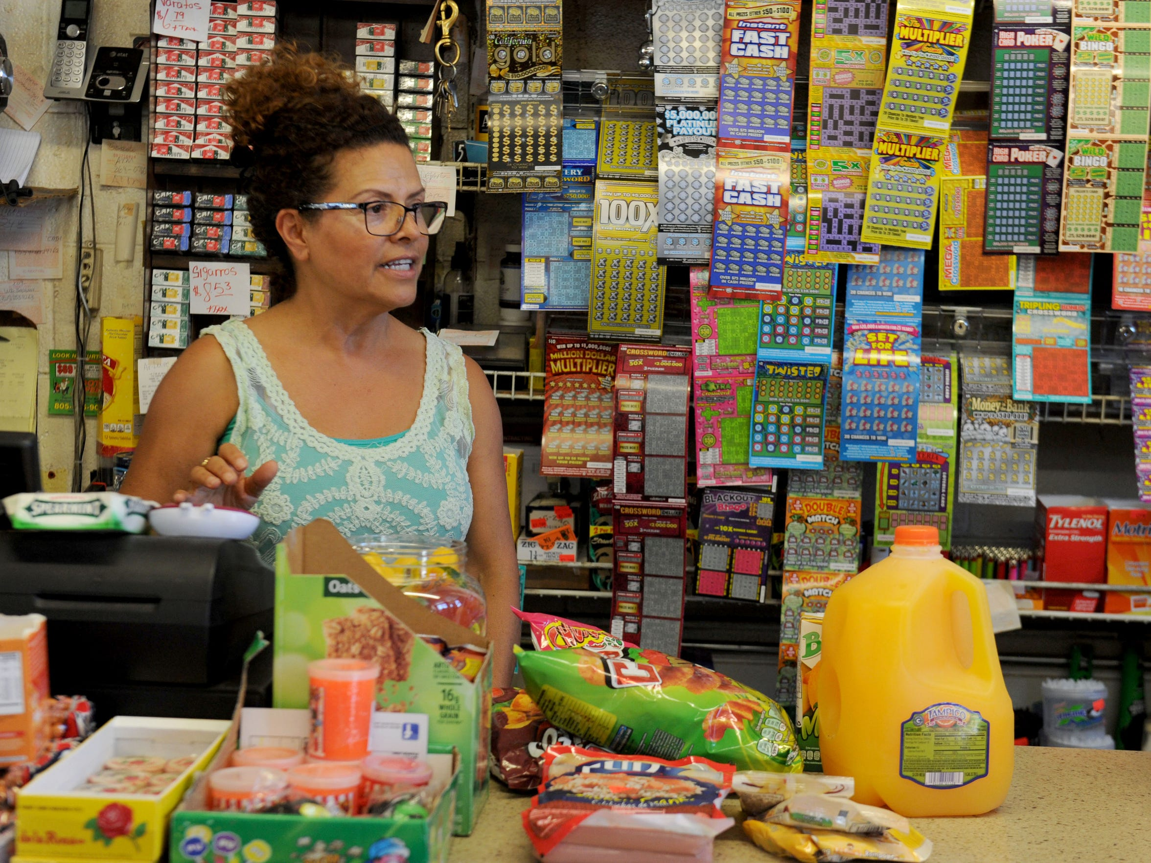 Alicia Estrada, co-owner of La Flor De Mayo, starts ringing up items for a customer. Her family has owned the small market and restaurant in Oxnard's La Colonia neighborhood for about 30 years. Estrada said many things have changed in the since the Colonia Chiques gang injunction was implemented nearly a decade ago.