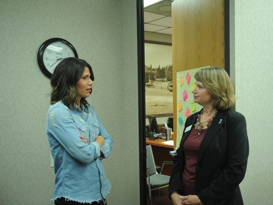 Rep. Kristi Noem talks with executive director of the