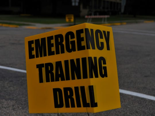 "An ""Emergency Training Drill"" sign alerted people Thursday"
