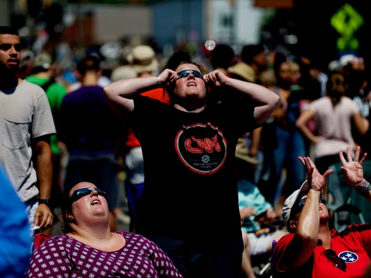 Visitors watch the solar eclipse during the total solar