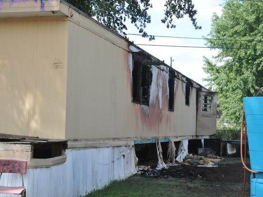 This mobile home on North Starr Place caught fire Thursday, Aug. 24, and damaged most of the home and a second one nearby. Nobody was injured.