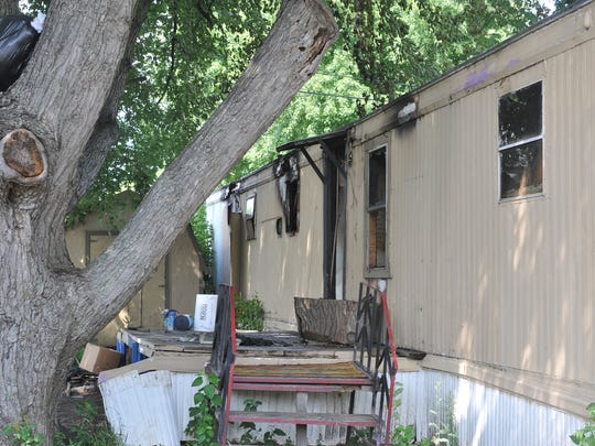 A mobile home on North Starr Place caught fire Thursday, Aug. 24, and damaged most of the home and a second one nearby. Nobody was injured. This home showed is the home damaged because of the smoke and heat.