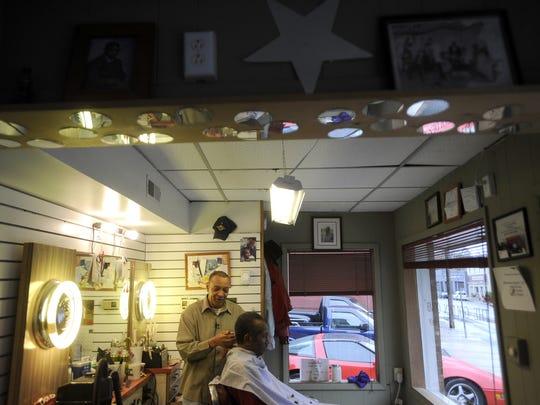Albert Timberlake cuts hair at Albert's Golden Comb in Staunton on Tuesday, Nov. 22, 2011.