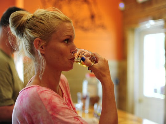 Heather Monaco, of Claymont, takes a sip from a the Brimming Horn Meadery taster. Flights of mead are one of the ways people have been introduced to this ancient drink that's soaring in popularity.