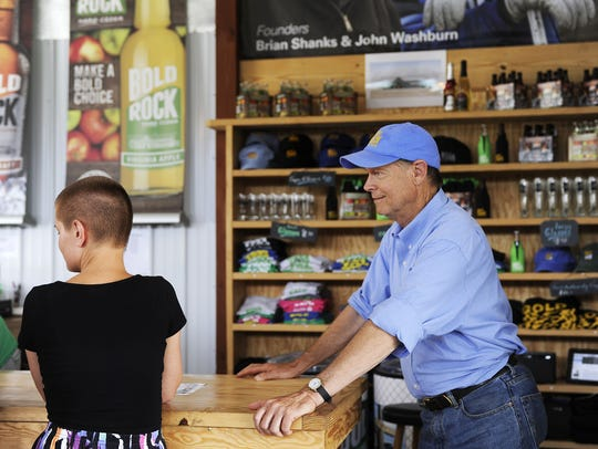 Owner John Washburn chats with customers in Bold Rock's