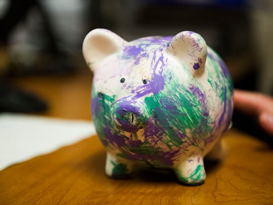 A piggy bank painted by a Guinea hog at Zoo Knoxville sits on a desk at Zoo Knoxville Tuesday, Sept. 5, 2017. Many animals at the zoo paint for enrichment.