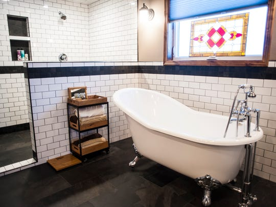 One Parade of Homes master bathroom features tile work by Warehouse Flooring.