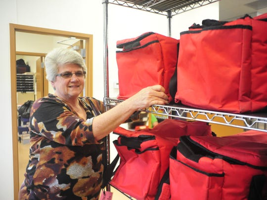 Virginia Hammontree pulls a hot meal bag off the rack at the Crawford County Council on Aging.