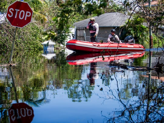 Members of the Lee County Sheriff's Office search for residents still stuck in their homes on Quinn Street after flooding after Hurricane Irma in Bonita Springs on Sept. 12, 2017.