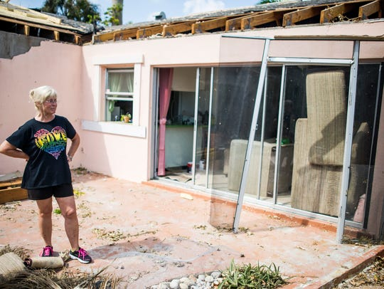 Laura Kirkman Leary stands in the remains of her lanai